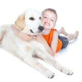 Pojke med en stor hund Arkivbild
