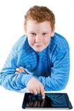 Pojke med en tabletdator Royaltyfri Foto