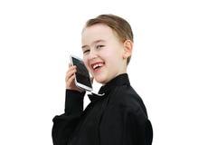 Pojke med en telefon Fotografering för Bildbyråer