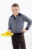 Pojke med en tennisracket Arkivbilder