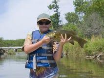 Pojke med fisken royaltyfria foton