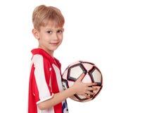 Pojke med fotboll Arkivbilder