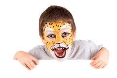 Pojke med framsida-målarfärg arkivfoto