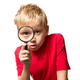 Pojke med förstoringsapparat Arkivbilder