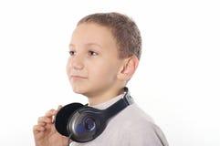Pojke med hörlurar Arkivfoton