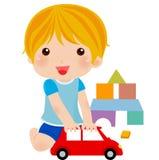 pojke med hans leksaker Royaltyfri Bild