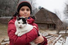 Pojke med katten Royaltyfri Foto