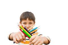Pojke med kulöra blyertspennor Royaltyfri Bild