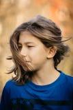 Pojke med långt hår Royaltyfria Bilder