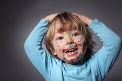 Pojke med målade framsidor Royaltyfria Foton