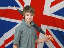 Pojke med paraplyet royaltyfria bilder