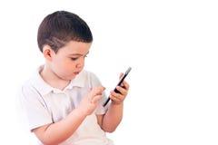 Pojke med tableten Royaltyfria Bilder