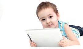 Pojke med touchpaden Fotografering för Bildbyråer