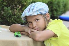 Pojke med toys Arkivbild