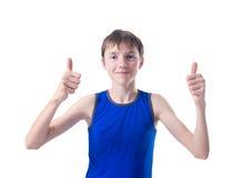 Pojke med två händer som visar tecknet av Royaltyfria Bilder
