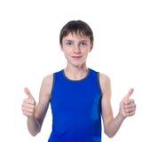 Pojke med två händer som visar tecknet av Arkivfoto