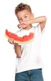Pojke med vattenmelon arkivfoton