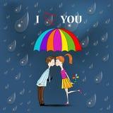 Pojke och en flicka under paraplyet. Royaltyfri Bild
