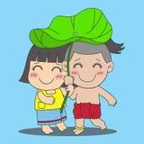 Pojke och flicka med lotusblommabladet Arkivbilder