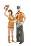 Pojke och flicka som ser som dockor Arkivfoto