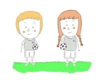 Pojke- och flickafotbollsspelare Fotografering för Bildbyråer