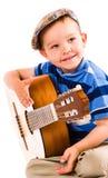 Pojke och gitarr Royaltyfria Bilder
