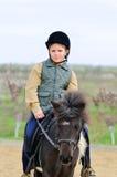 Pojke och hans Shetland ponny fotografering för bildbyråer