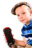 Pojke- och leksakbil Fotografering för Bildbyråer