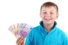 Pojke och pengar royaltyfri fotografi