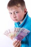 Pojke och pengar royaltyfria bilder