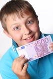 Pojke och pengar royaltyfri bild