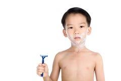 Pojke och rakapparat Arkivfoton