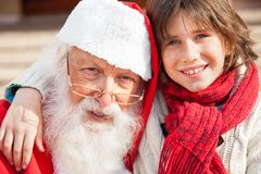 Pojke och Santa Claus Smiling Royaltyfria Bilder