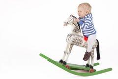 Pojke och trävagga häst Royaltyfria Bilder