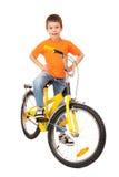 Pojke på cykeln på vit royaltyfria foton
