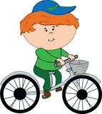 Pojke på en cykel Royaltyfria Foton