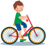 Pojke på en cykel Fotografering för Bildbyråer