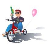 Pojke på en cykel Arkivfoto