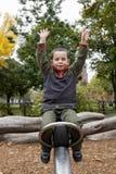 Pojke på en rem royaltyfria bilder