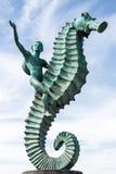 Pojke på en Seahorse Arkivfoto