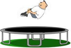 Pojke på en trampoline Arkivbilder