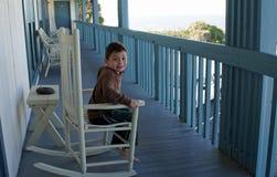 Pojke på gungstol Royaltyfri Fotografi