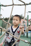 Pojke på lekplats Royaltyfria Bilder