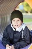 Pojke på lekplatsen Fotografering för Bildbyråer