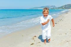 Pojke på stranden Royaltyfria Foton