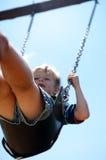 Pojke på swing Arkivfoto
