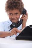 Pojke på telefonen Royaltyfria Bilder