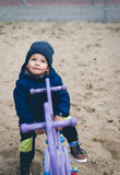 Pojke på vårgunga Fotografering för Bildbyråer
