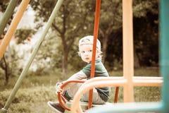 Pojke på en Swing Royaltyfri Fotografi