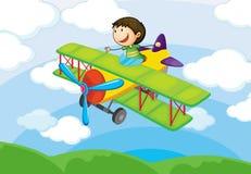 Pojke på ett lufthantverk Royaltyfri Bild